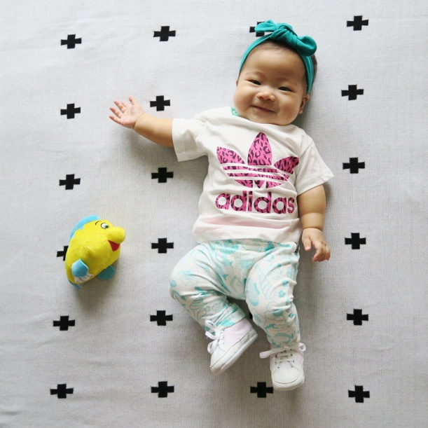 Blanket from Jamiekay; Bow from thelittlebowco; Tee from Adidas; Leggings from Bonds; Shoes from H&M; Flounder from Singapore Airlines.