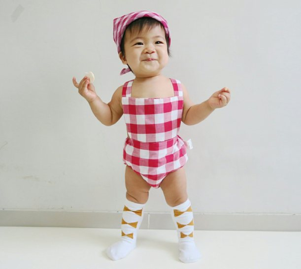 Gingham romper and knee high gold ribbon socks from @hubbleandduke and reversible bibdana worn as headscarf from @paperplanekids.